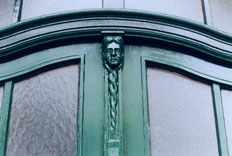 "[""The Girl in the Door"": photo of a carved figure of a girl as part of a Berlin doorway]"